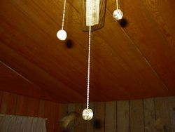Shotgun Shell Ceiling Fan Light Pull shown on ceiling fan