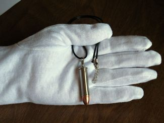 Bullet Necklace in hand